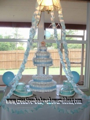 blue and white wedding style diaper cake with baby bootie cakes