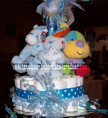 closeup of stuffed animals on top layer of diaper cake