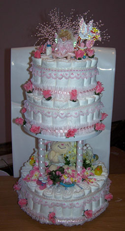 pink lace and rosebuds diaper cake
