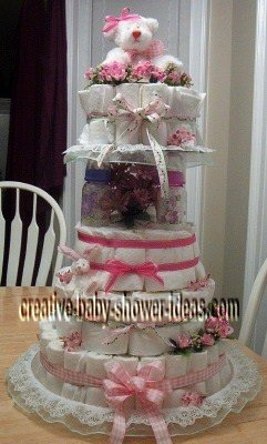 pink and white baby bottle diaper cake