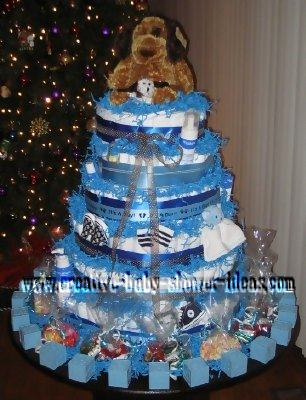 blue dog diaper cake with baby block favors