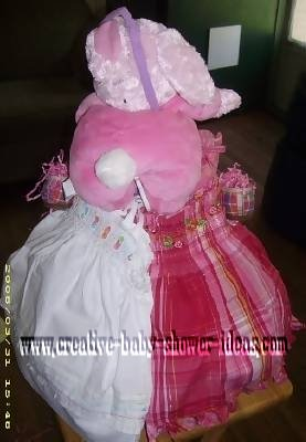 baby of pink bunny diaper cake showing 2 cute dresses
