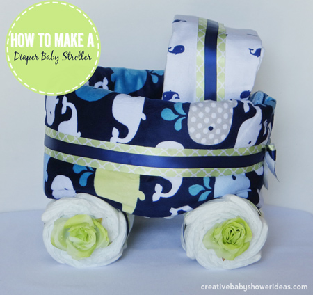 Blue and green nautical themed diaper baby carriage