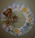 diaper wreath decorated with brown bear and flowers