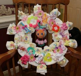 blue and pink glow worm diaper wreath instructions