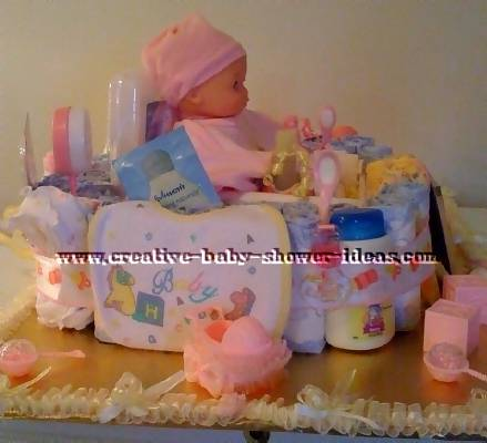 baby doll in basket diaper cake