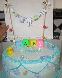 closeup of baby blocks and clothesline on cake