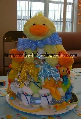 yellow duck diaper cake with ribbon tie