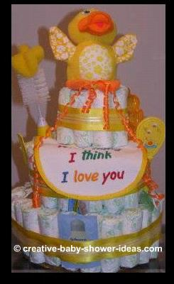 yellow duck diaper cake with I think I love you bib