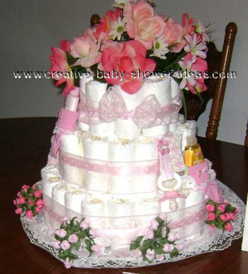 pink and white flowers diaper cake