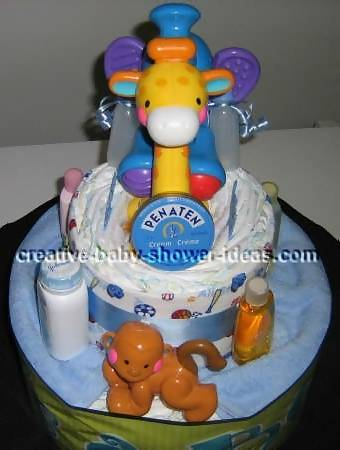 front of jungle diaper cake showing plastic giraffe, monkey and elephant
