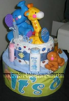 2 tier jungle diaper cake with plastic animals and miniature baby supplies