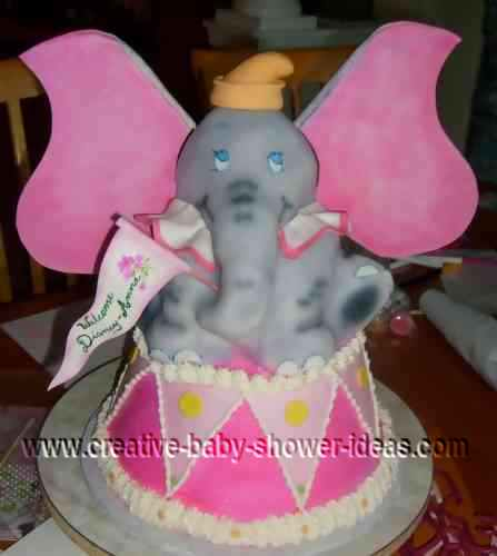 dumbo elephant baby shower cake with flag and drum
