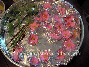 making the fondant flowers for the basket baby shower cake