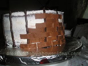 creating the frosting basket weave for the baby cake