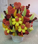 eldible fruit bouquet with watermelon pinneaple grapes honeydew and cantaloupe