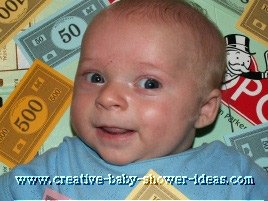 baby smiling laying on a monopoly board game