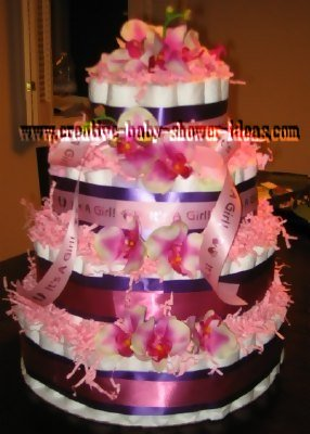 pink and purple its a girl diaper cake