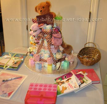 girl bear diaper cake on baby shower table