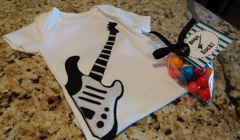 black and white guitar onesie