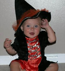 baby girl in a halloween witch costume