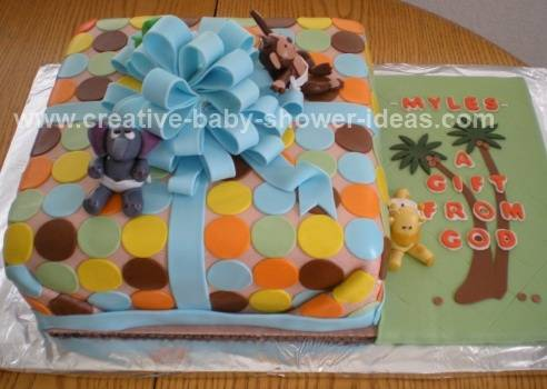 blue and pink polka dot jungle baby shower cake