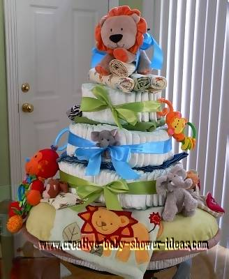 green and blue lion diaper cake