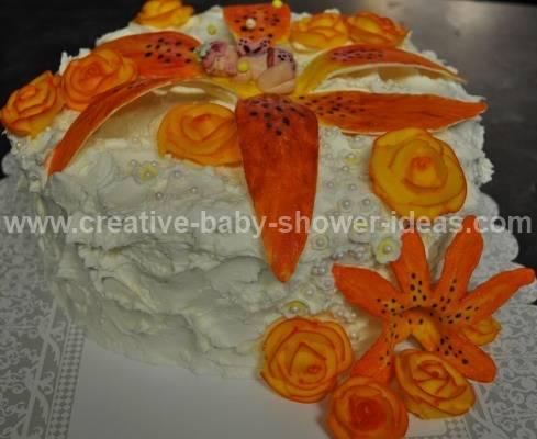 elegant cream baby cake with baby sleeping on orange flowers