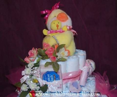 closeup of top of mommy and baby duck diaper cake
