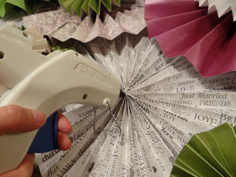 hot gluing paper rosettes together