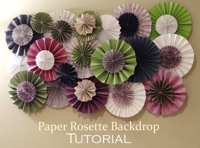 green and purple paper rosette backdrop