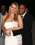 Mariah Carey and husband smiling happily