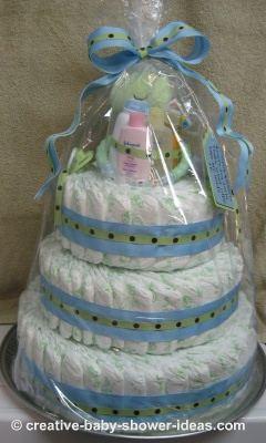 finised frog diaper cake wrapped in cellophane