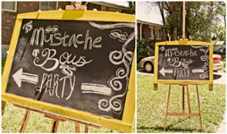 yellow chalkboard sign for gender reveal party