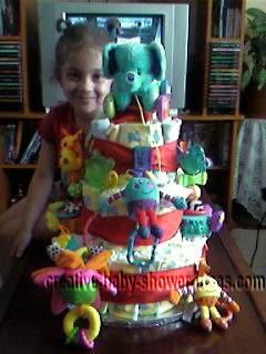 girl smiling by colorful animals diaper cake