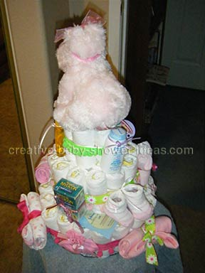 back of pink hippo nappy cake