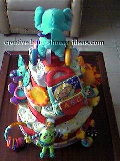 back of colorful animals diaper cake