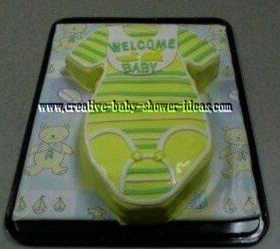 yellow and green onesie baby shower cake