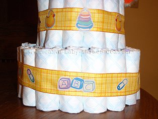 bottom layer of duck diaper cake showing plaid ribbon