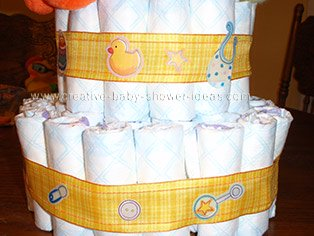 plaid ribbon with baby items for duck  diaper cake