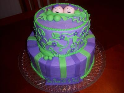 purple and green peas in a pod cake with stripes and flowers on the side