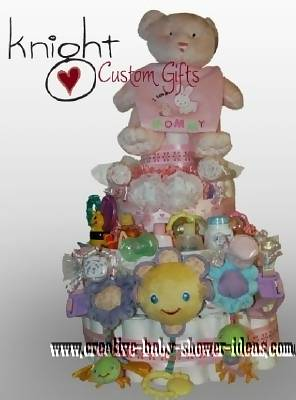 pink and cream teddy bear diaper cake