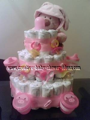 pink teddy bear and pacifiers diaper cake