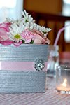 closeup of table decorations at a baby sprinkle party pink and grey modern colors