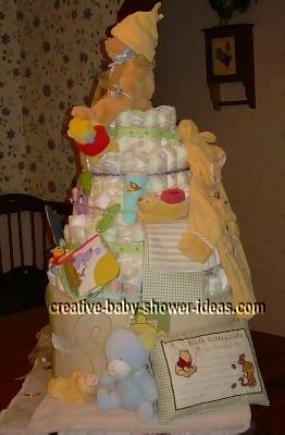 side view of winnie the pooh diaper cake showing baby pillow