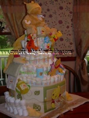 another view of winnie the pooh diaper cake showing blankets