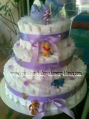 purple and white winnie the pooh diaper cake
