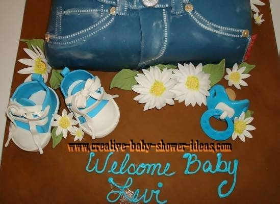 closeup of blue jean shorts flowers and sneakers for belly cake