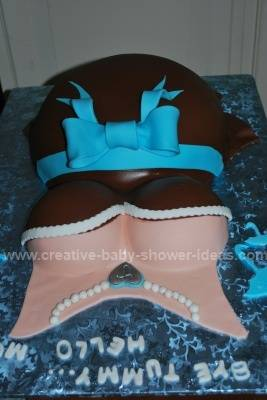 pregnant belly cake from the front showing necklace details
