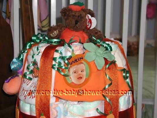 closeup of baby picture on lil pumpkin diaper cake